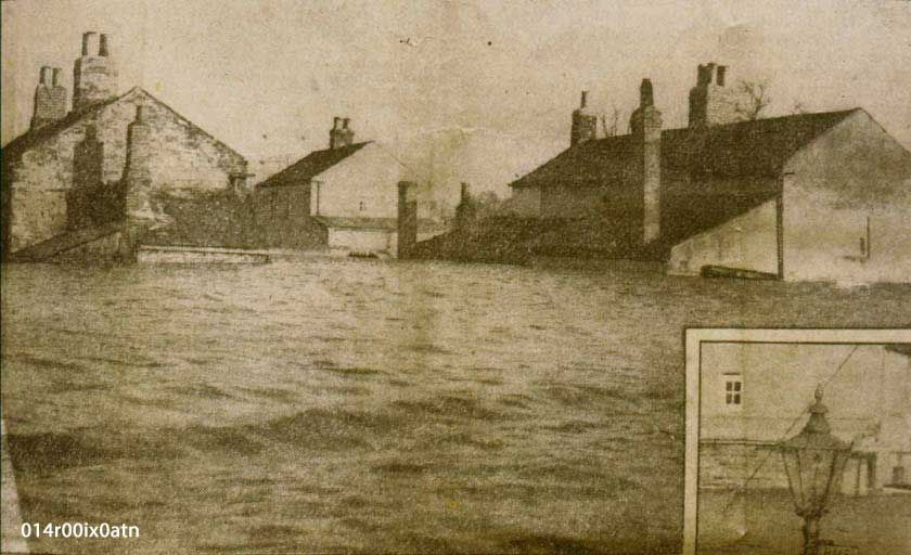 Cottages in Watergate, surrounded by floodwaters