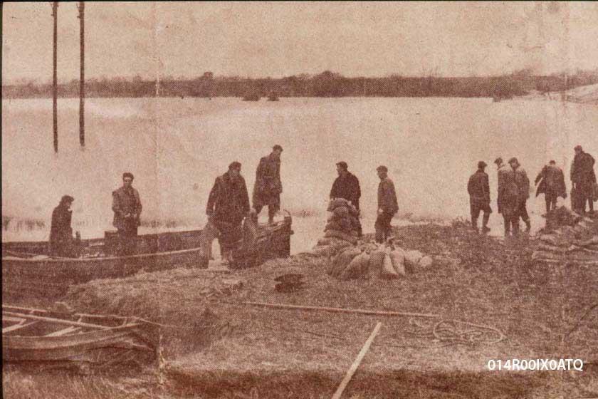 Workmen repairing the breached river bank of the River Calder.